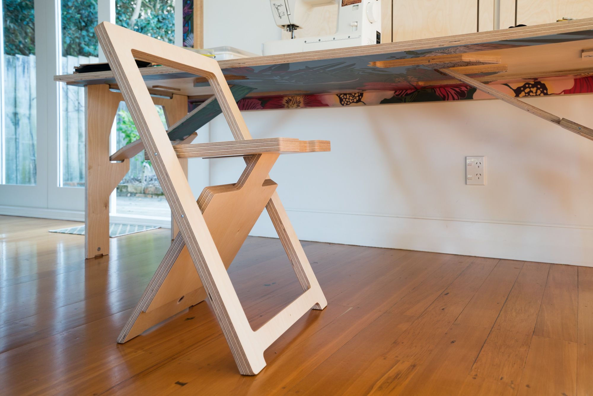 Hang extra folding chairs on the wall