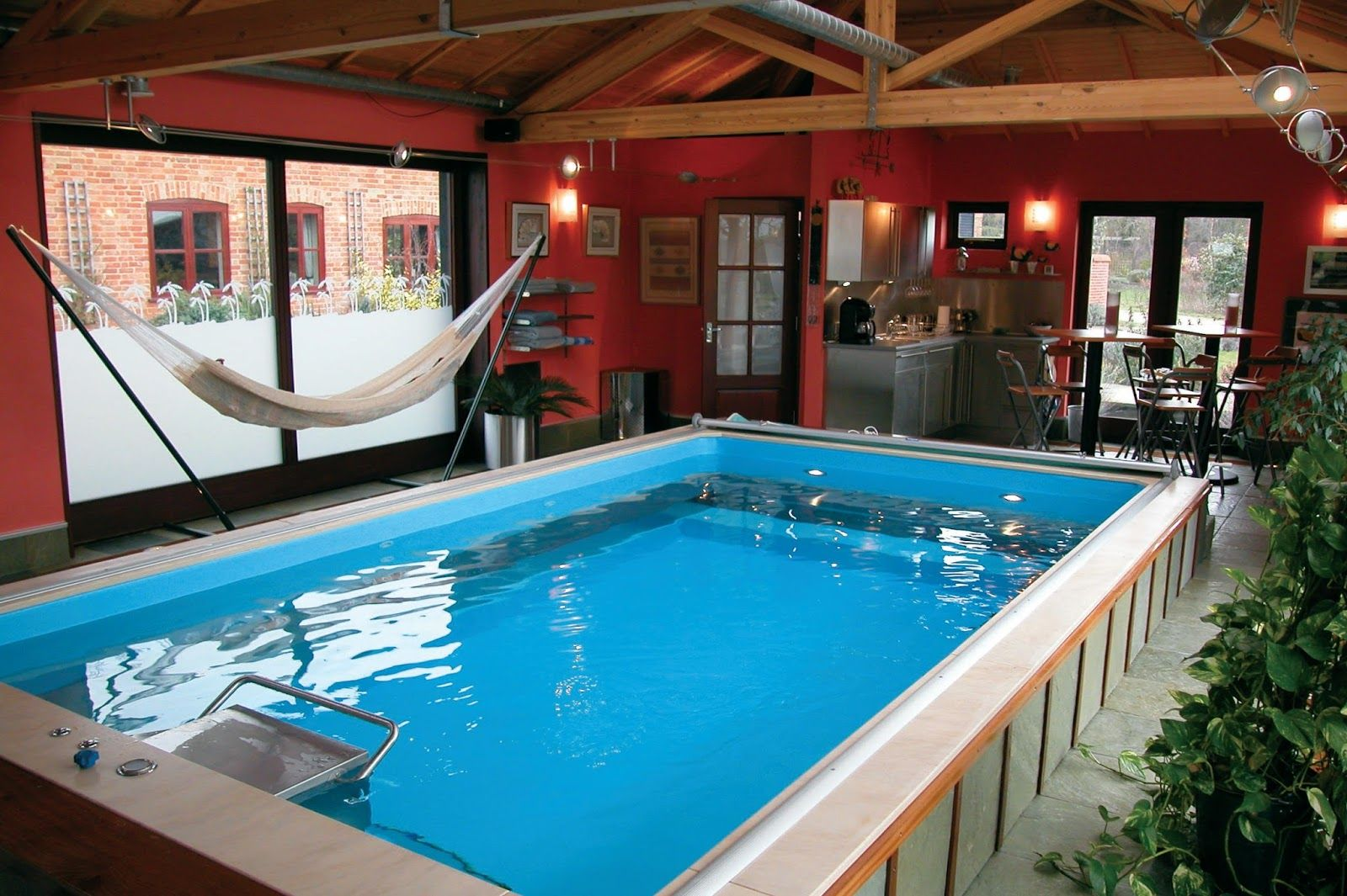 Inside Pool Cave deep red walls and exposed wood beams define this man cave with a