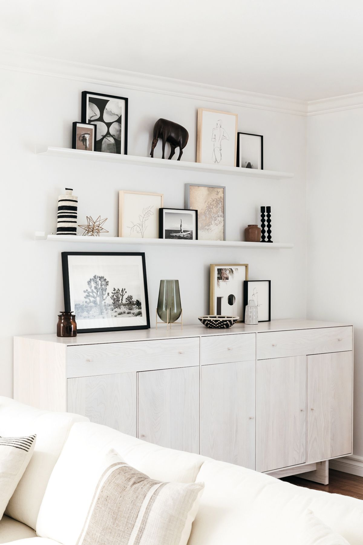 Dining Room Shelving With Framed Art Gallery Wall On Ledge Shelves Grey Washed Wood Custom Cabinet Neutral Decor Black And White Eatsleepwear