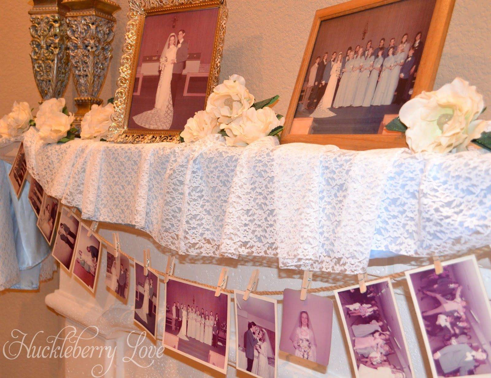 Blow up and frame wedding day photos and hang smaller ones above ...