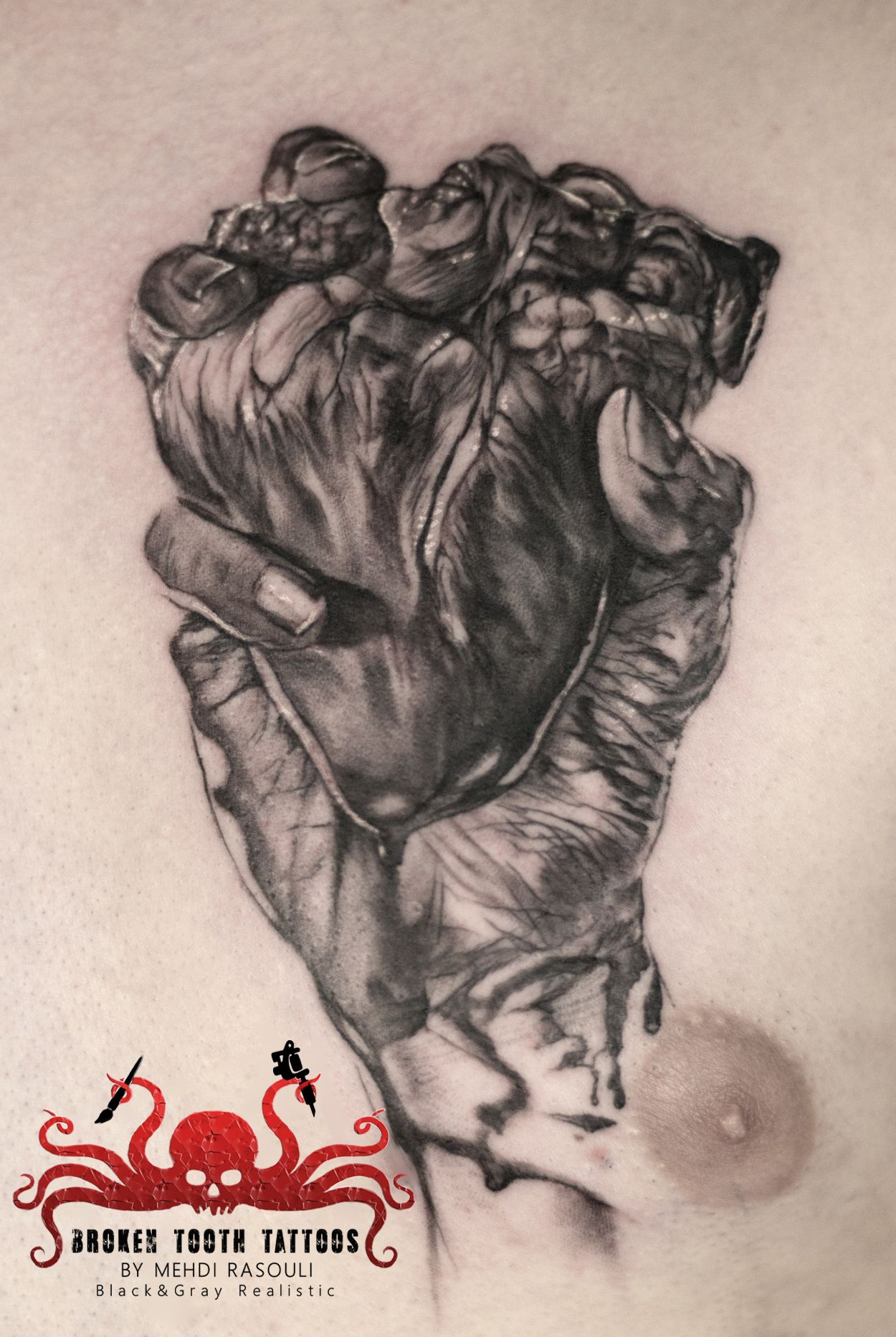 heart in hand tattoo by mehdi rasouli broken tooth tattoos