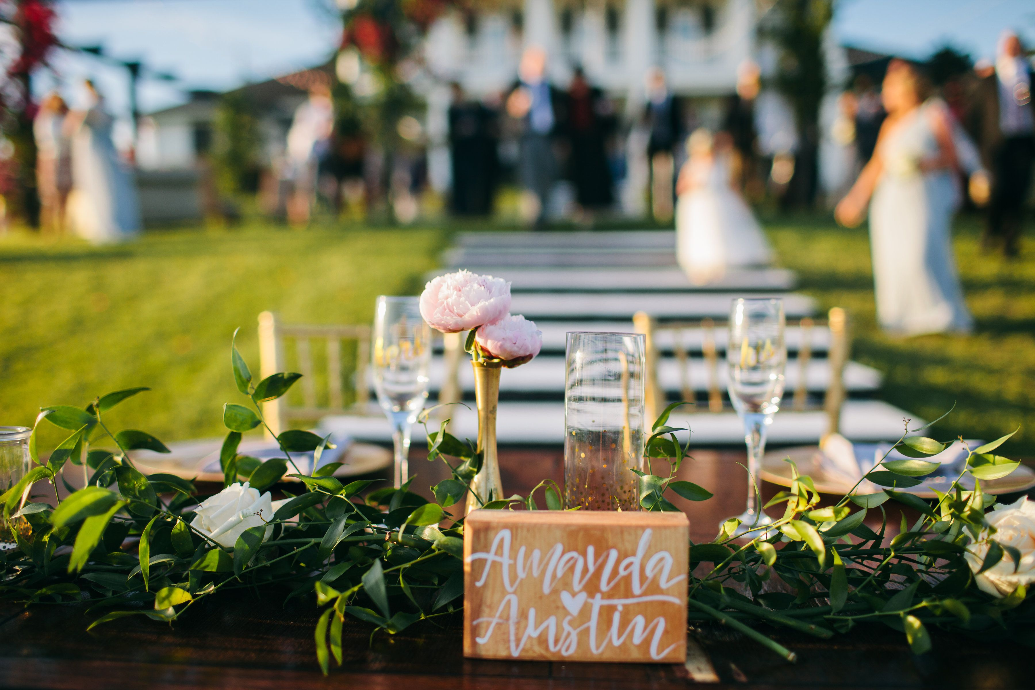 Barrington hill design sweetheart table with garland and peonies