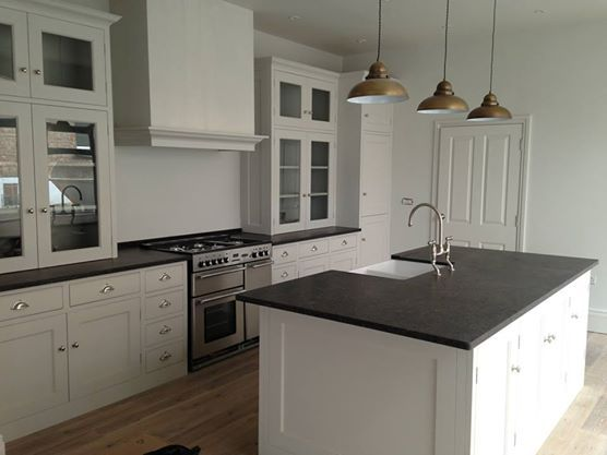 White Kitchen Units Black Worktop picture of a white shaker style kitchen with black honed granite