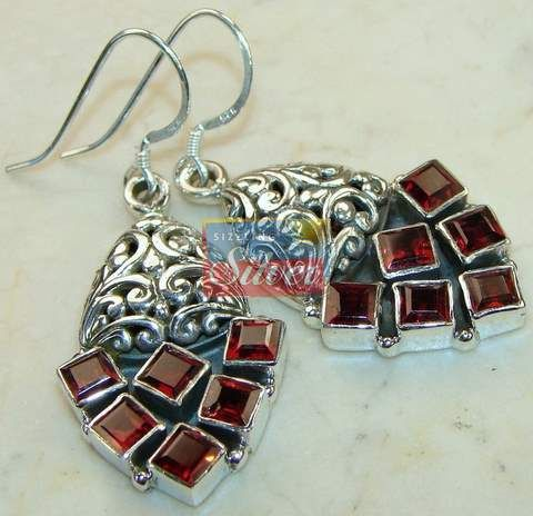 Beautiful item with Garnet Faceted Gemstone(s) set in pure 925 sterling silver.