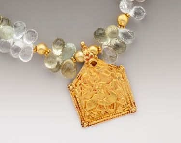 """Clarity: An antique 20K-22K Indian plaque amulet of Bhumiya Raj riding his trusty steed, on faceted multi-colored drops of beryl - aquamarine, heliodore, morganite and clear beryl. 18K gold accents. Pendant drop 1/1/2"""".  (SOLD) #elleschoeder #indian #antique #amulet #bhumiyaraj #necklace #jewelry #ancientsplendor #22K #18K #oneofakind #aquamarine #heliodore #morganite #beryl"""