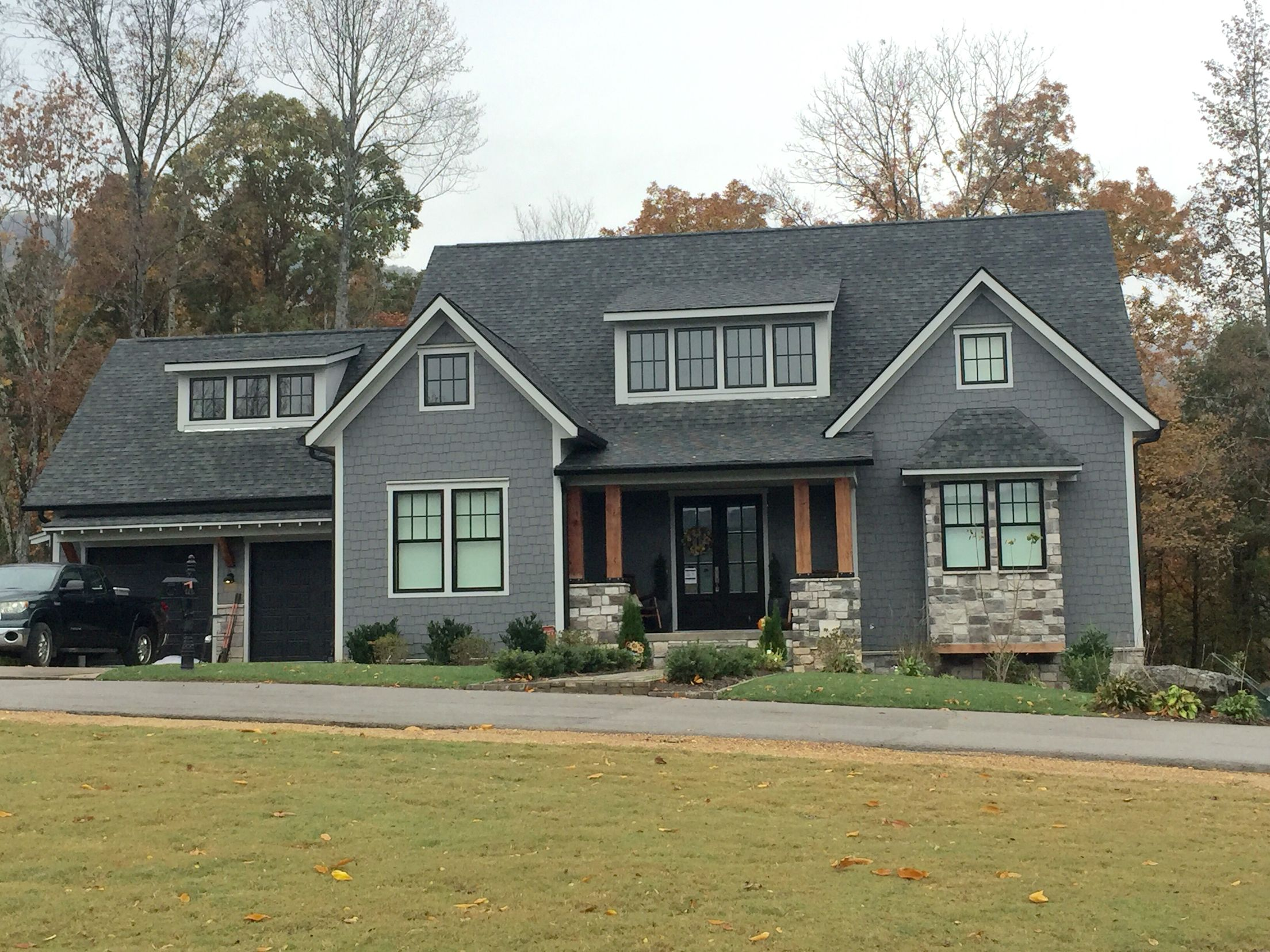 Home exterior with the exception of the garage doors do Black brick homes