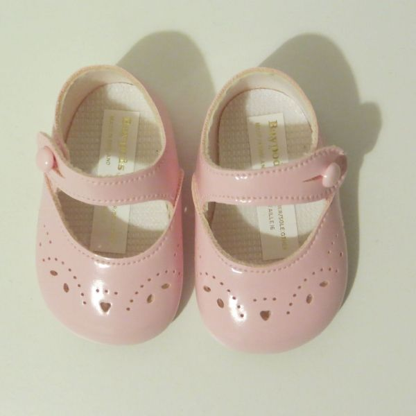 Cute baby girl pram shoes in pink patent from the Baypods range by Early Days The pretty baby shoes fasten with a strap and button and have been