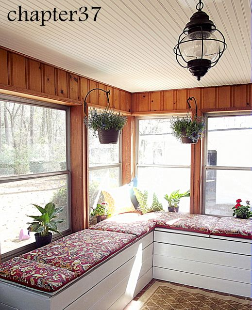 beadboard ceiling and fresh plants...just the right amount of cozy for a sunny sun room