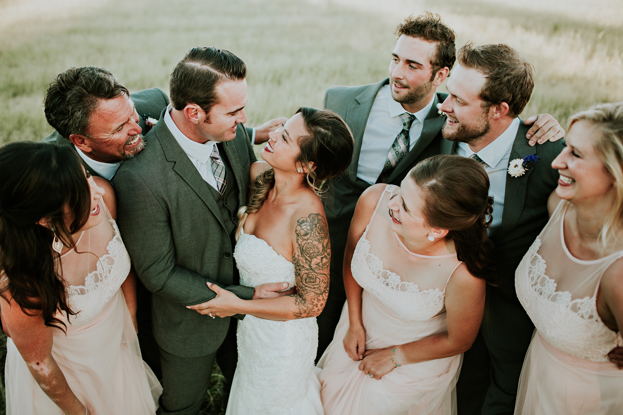 Wedding Party all enjoying a moment between the bride and groom.    photo by: TGTB COLLECTIVE  Tacoma wedding photographers  rustic barn wedding / PNW