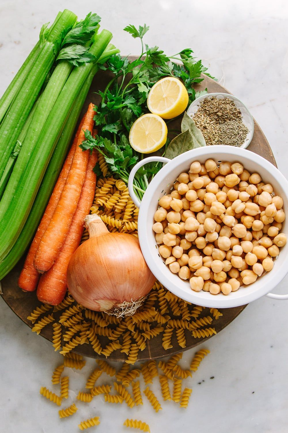 Vegan Chickpea Noodle Soup is loaded with veggies, protein rich chickpeas, hearty pasta & flavorful herbs, and ready in 30 minutes! May I also add that this recipe requires minimal chopping, uses mostly pantry ingredients and is a budget friendly lunch, dinner or meal prep idea. It's sure to be a new healthy favorite for the meal rotation! #chickpeanoodlesoup Vegan Chickpea Noodle Soup is loaded with veggies, protein rich chickpeas, hearty pasta & flavorful herbs, and ready in 30 minutes! May I #chickpeanoodlesoup