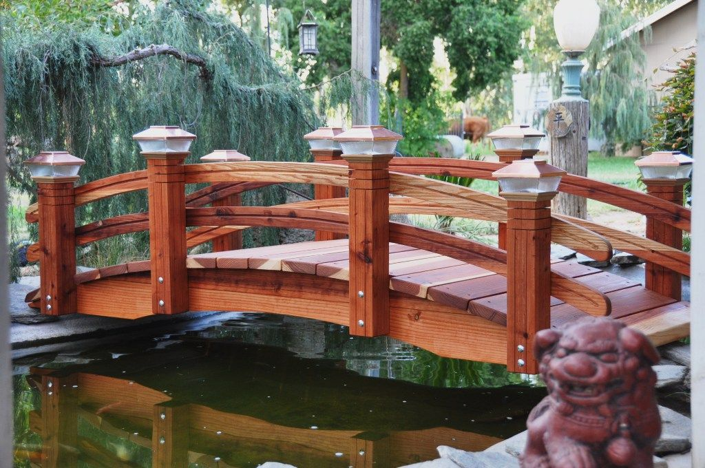 There Are Many Uses For A Wooden Garden Bridge Which Will