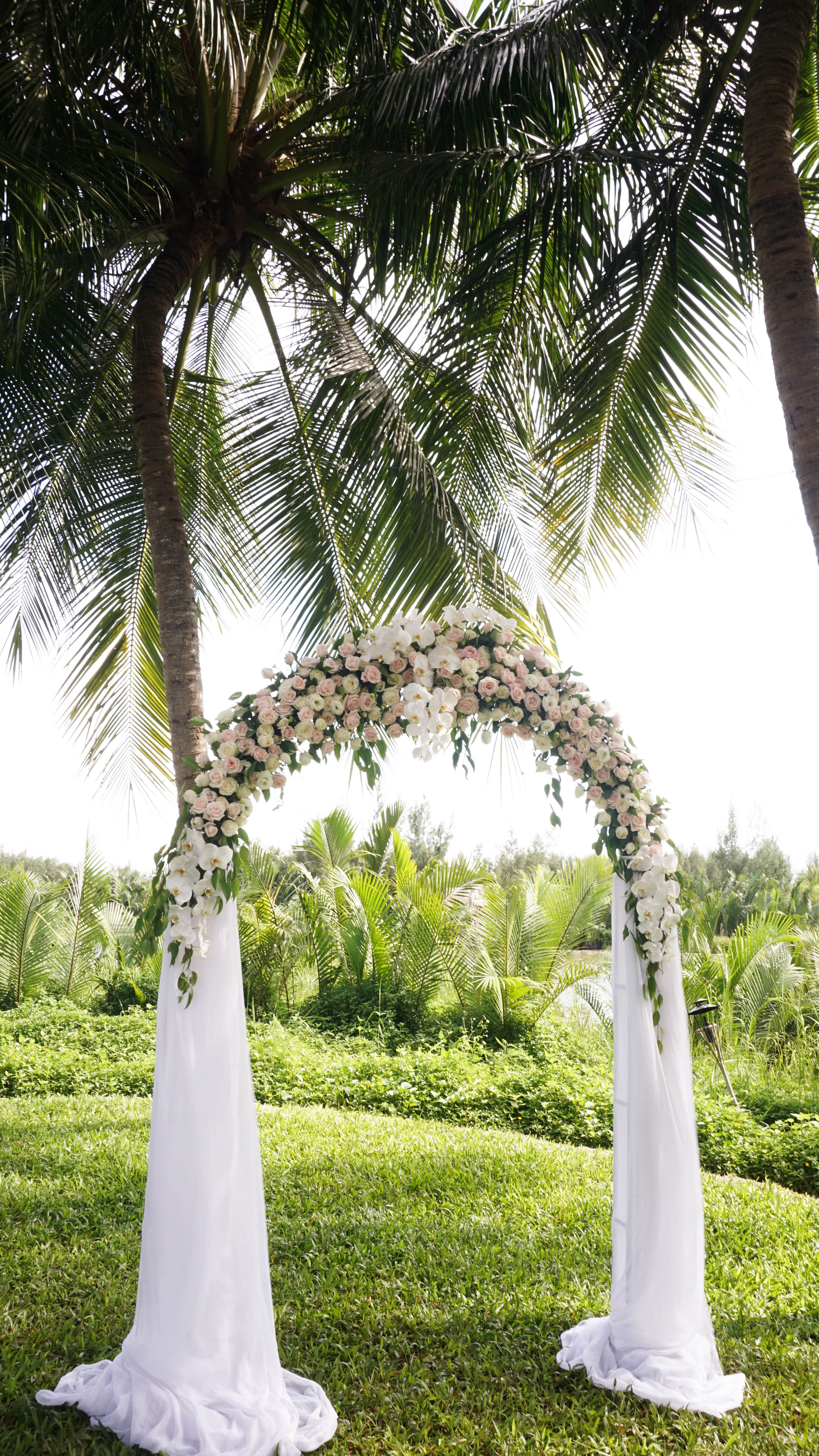 Flowing white floral fabric archway for your fairy tale