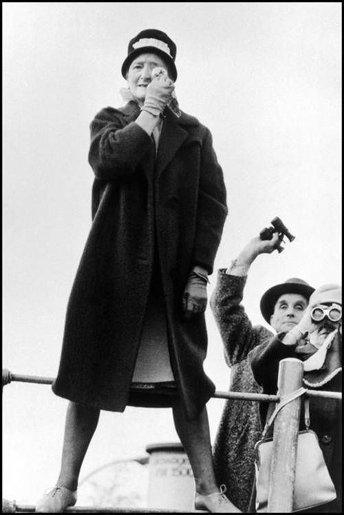 West Berlin. 1961. West Germans in Berlin try to make visual contact over the Berlin Wall with friends and family in East Berlin. By Burt Glinn