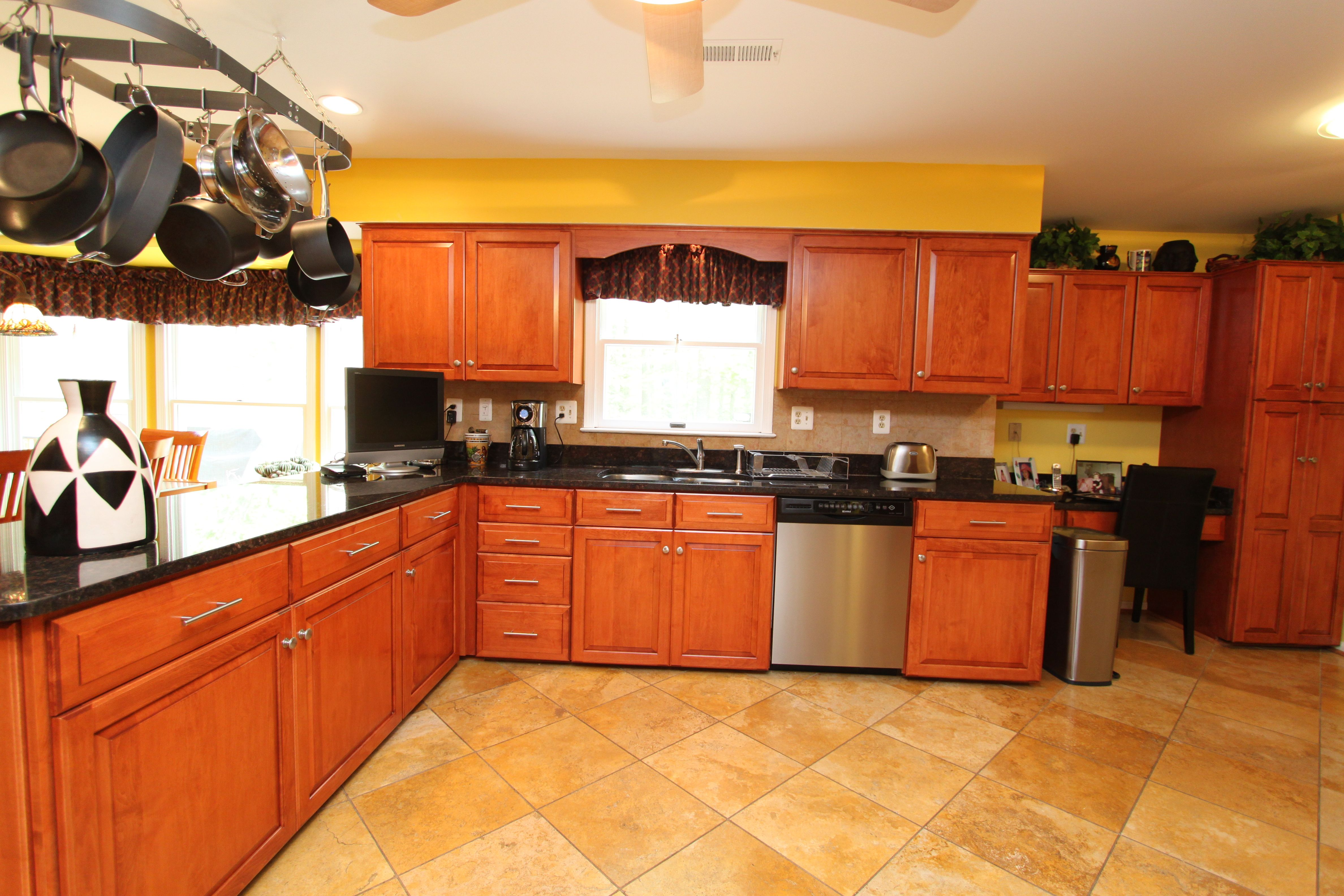 This was a golden oak kitchen that was refaced by Kitchen Saver Now