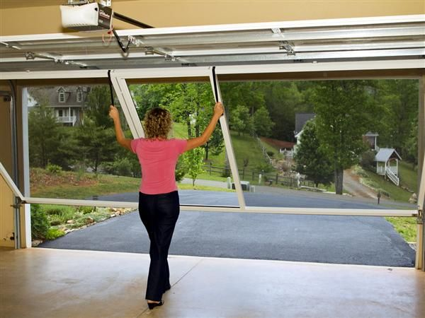 Lifestyle garage door screens are a great way to screen in for Roll down garage door screen
