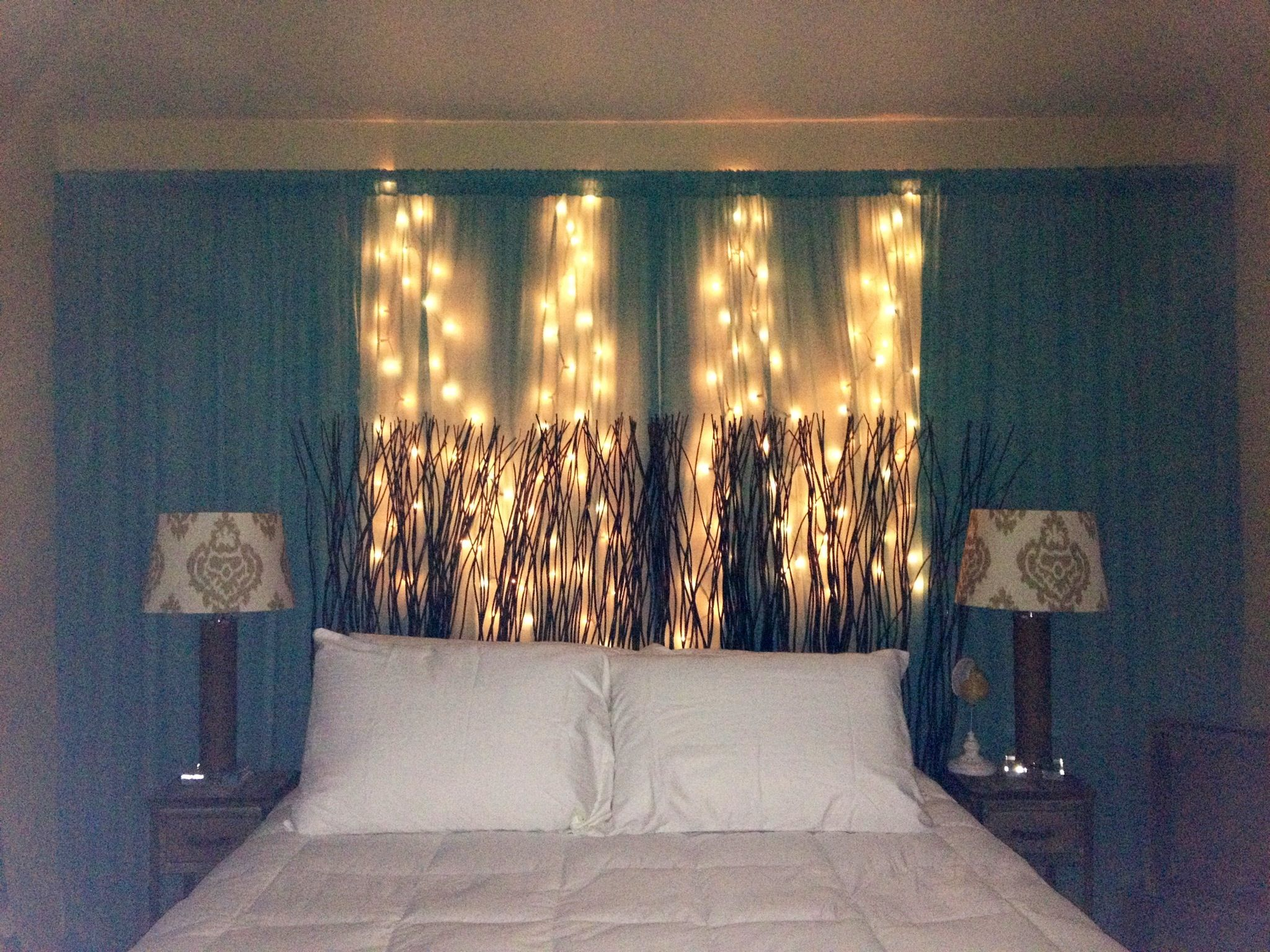DIY Curtain & string lights behind headboard; on wall instead of windows.