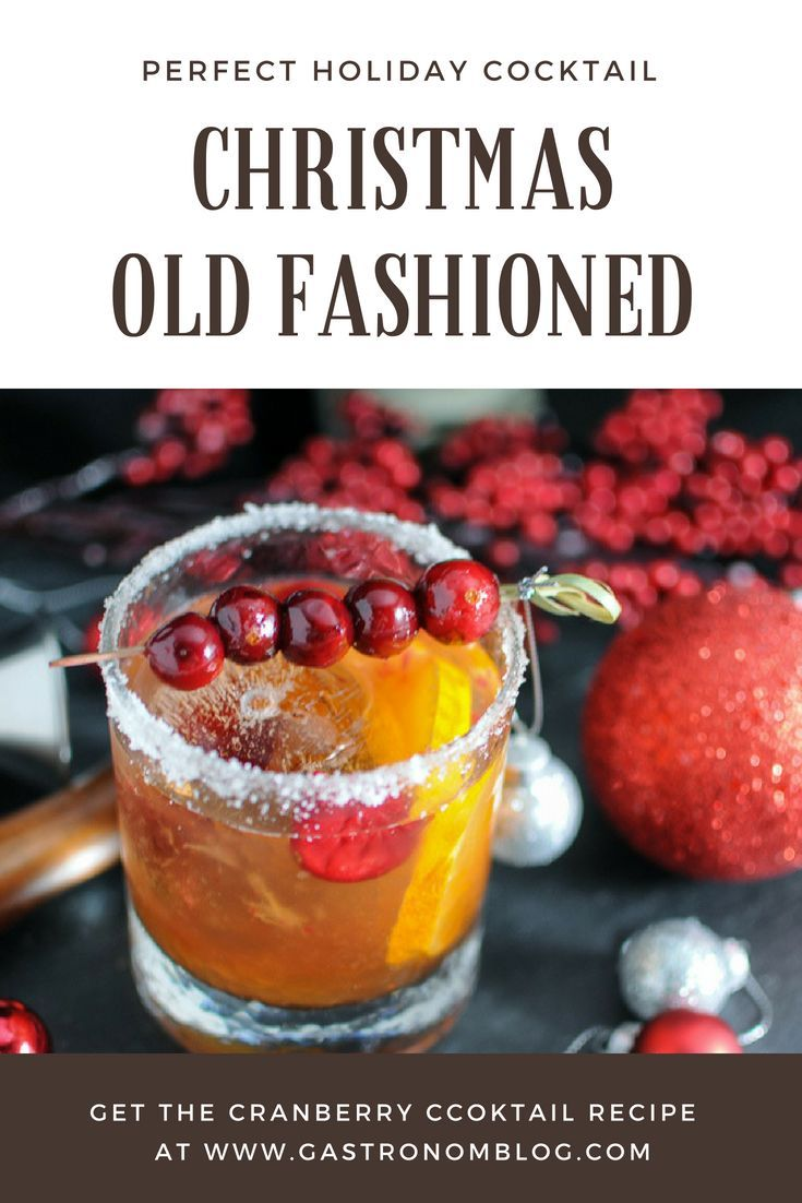 Christmas Old Fashioned - a holiday twist on the classic cocktail. Cranberry simple syrup, Angostura bitters, Rye whiskey, orange and cranberries. #cocktail #cocktails #drink #drinks #classic #whiskey #orange #recipes #cranberry #easy #Christmas #holiday #cocktaildrinks