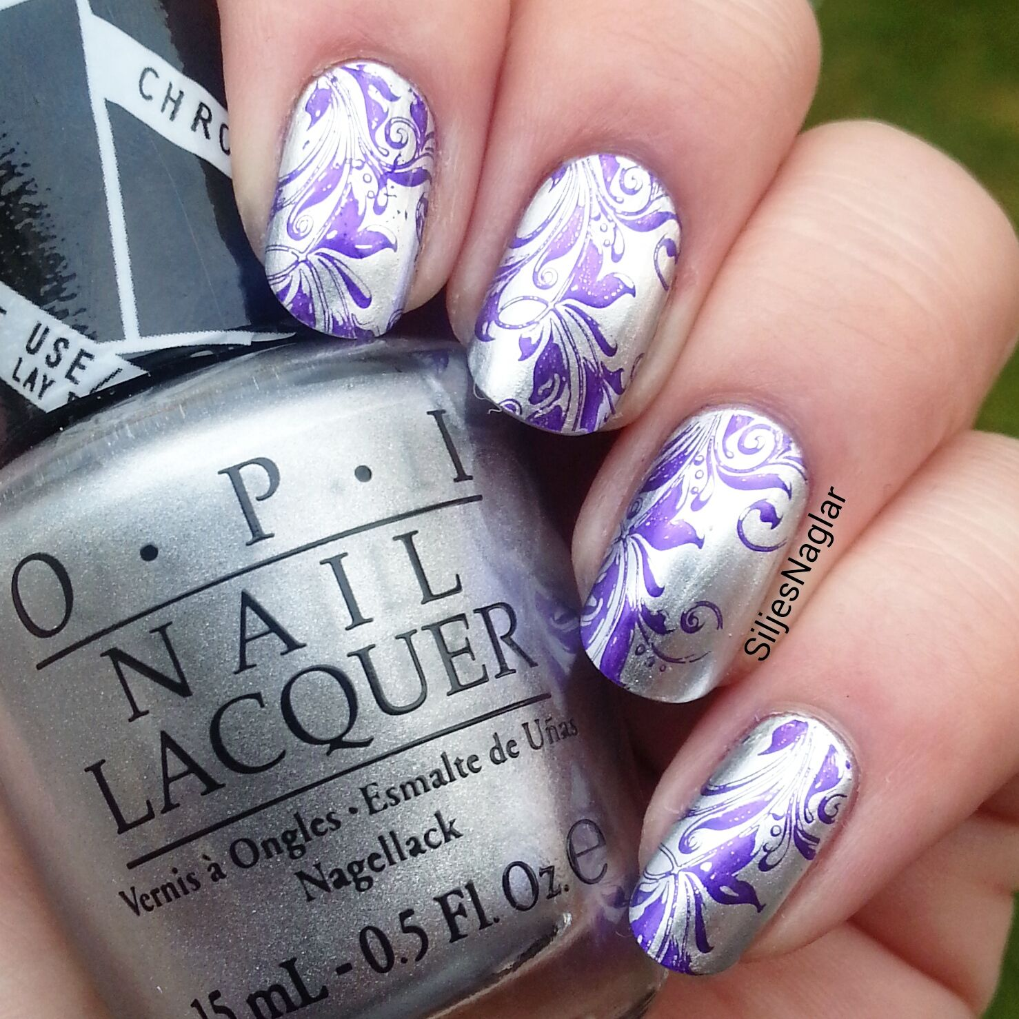 Opi Push and shove with purple stamping nail art.