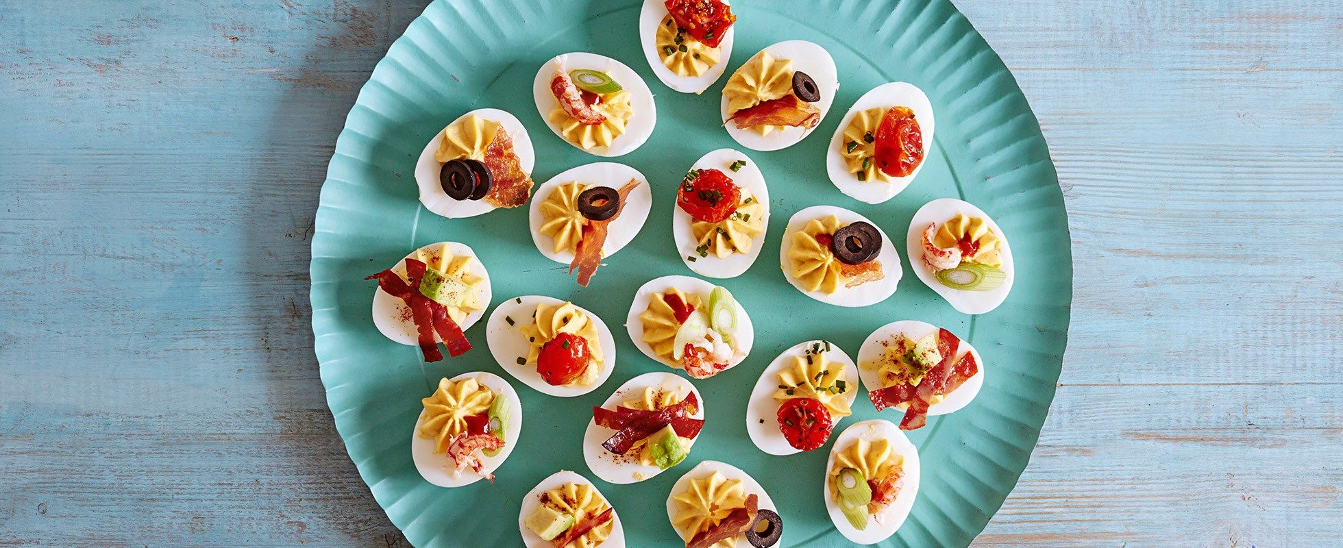 Devilled eggs are a retro nibble that have recently become trendy. The base stays the same, but you can add different toppings depending on what you fancy.