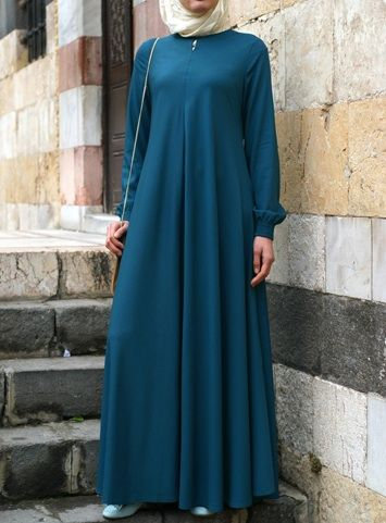 Easy Care Flared Abaya Teal color asked for it, and we are happy to oblige: Finally, a wrinkle-resistant version of our popular abayas! The name says it all, and it's as easy to wear as it is to care for. Elasticized sleeves, a front opening, and the perfect flattering, feminine flair work together to create one beautiful, practical piece you'll be reaching for day after day.