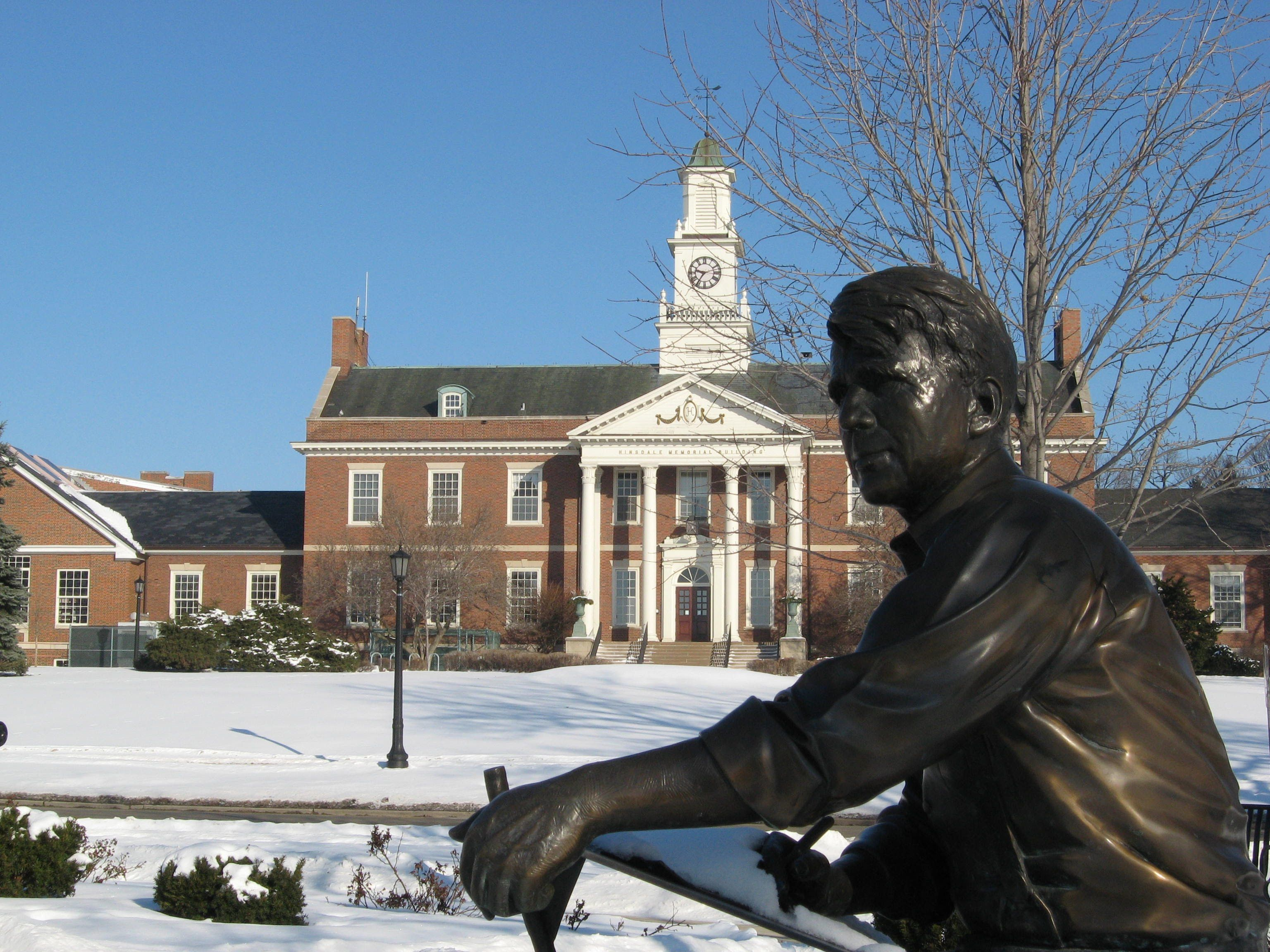 Robert Frost statue with Memorial Hall in the background.