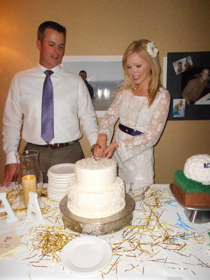 Rehearsal Dinner.  I wore ivory lace as a foreshadow for the next day.. we did not have a wedding cake (By choice) but wanted to share a moment like that with family & Friends, so at the rehearsal dinner, we have a mini wedding cake made of three flavors and I had a grooms cake designed...into a golf ball!!