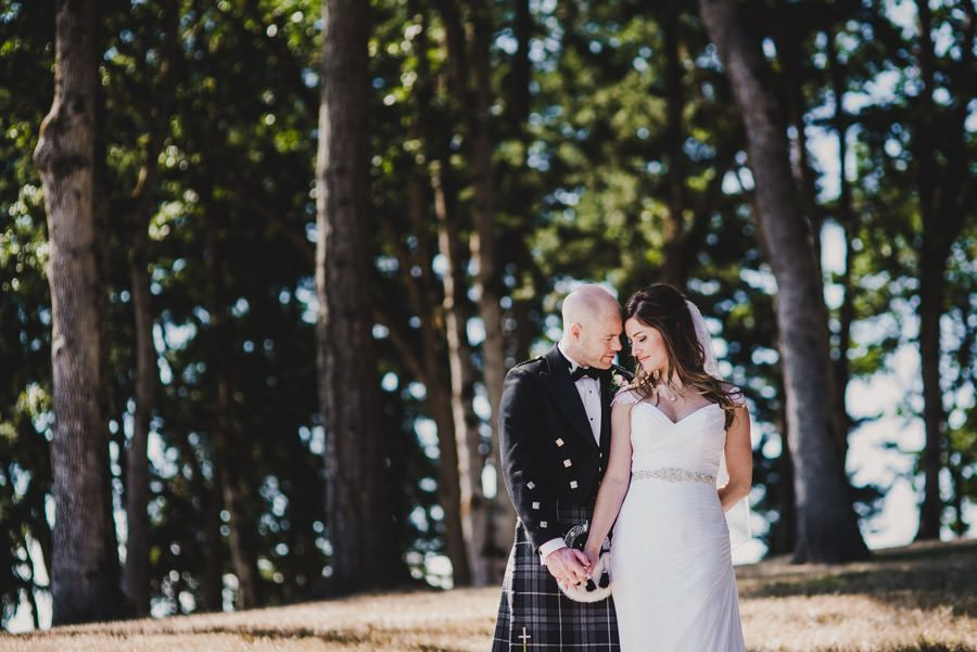 Scottish Kilts Storm An Eola-Amity Hills Vineyard Wedding - Kyle Carnes Photography - Stella York Wedding Dress