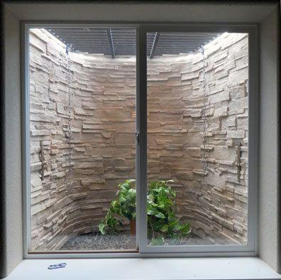 Basement Window Well Designs make ugly basement window wells pretty | customwindowwells