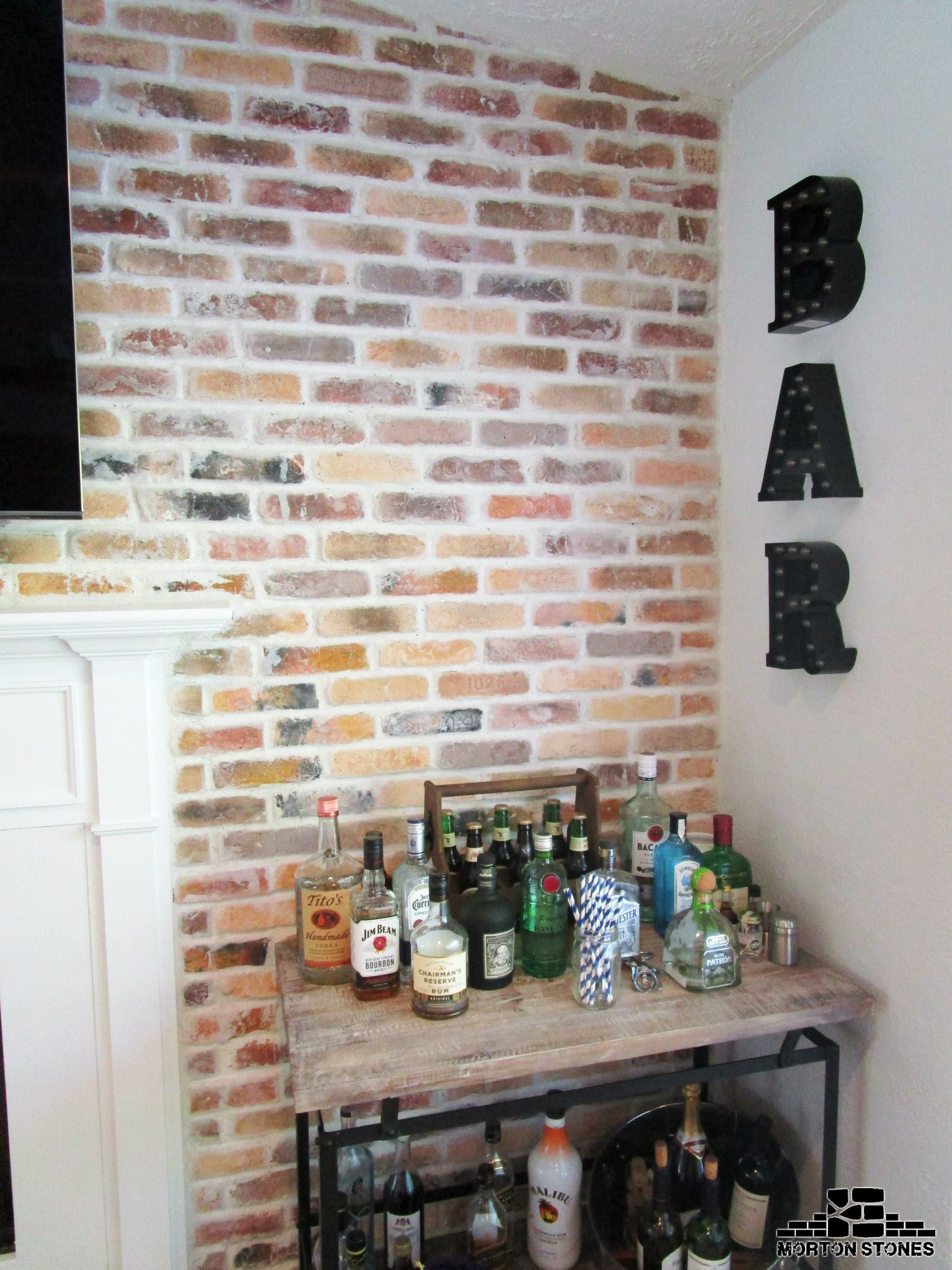 A Cozy French Country Space With A Brick Veneer Wall In Different Shades.  #mortonstones