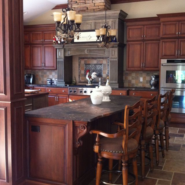 Two tone kitchen. Green wood hood and warm cherry cabinets. Leather ...