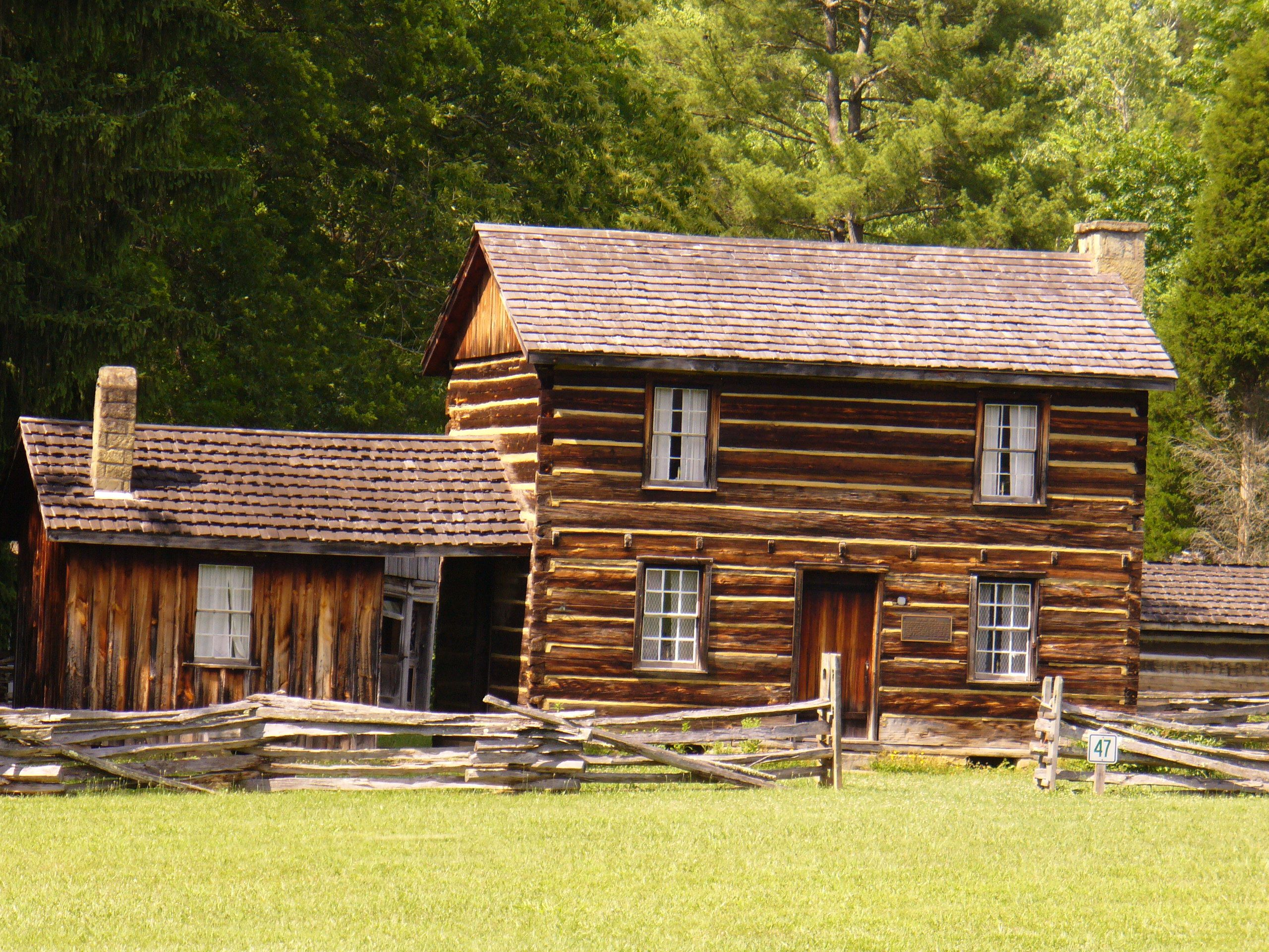 cabins west log harman luxury by of s surrounded snow bedroom virginia cabin covered exterior ground our tour at view