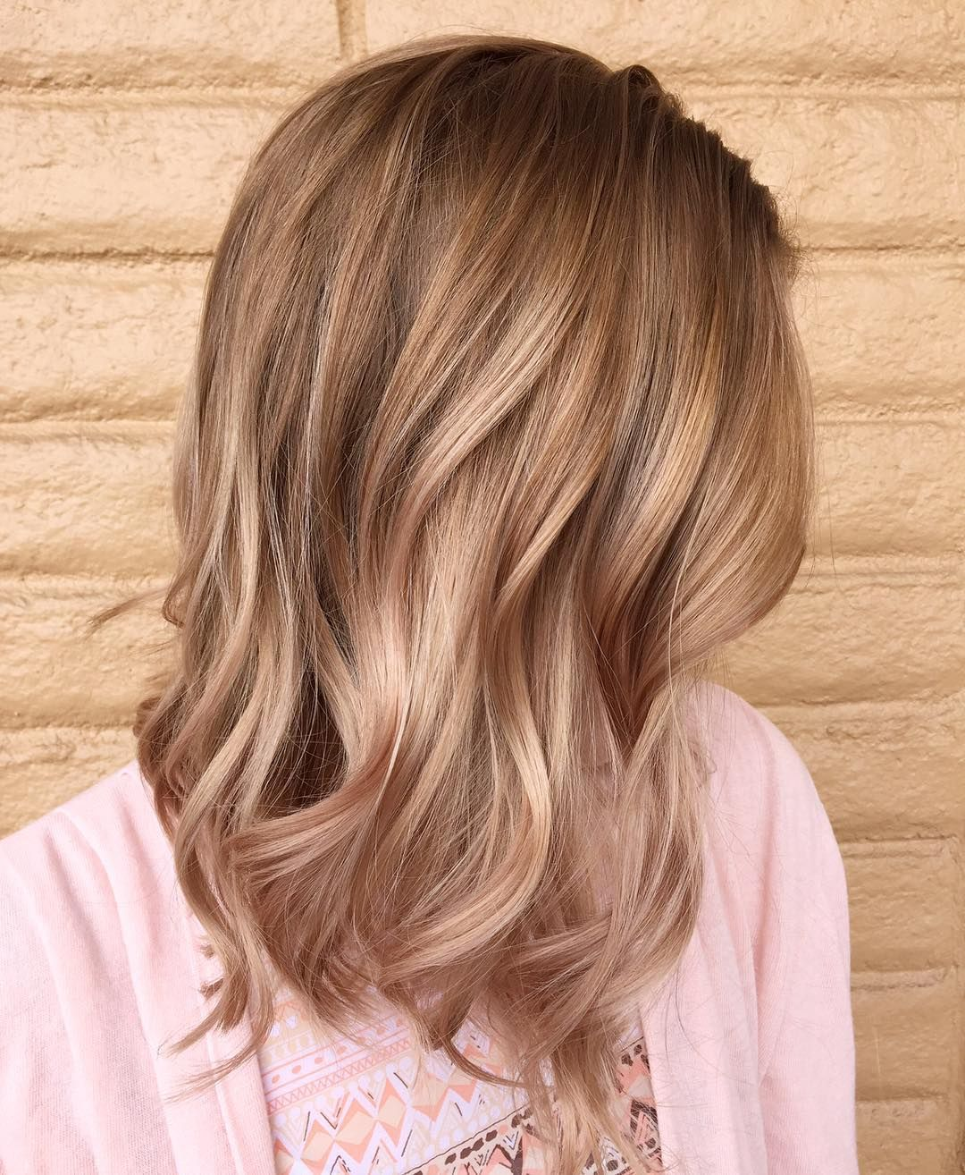how do you neutralize red tones in blonde hair