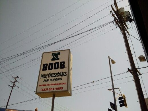 Sign of restaurant 'BOOS'  :  philly cheese steaks sandwich