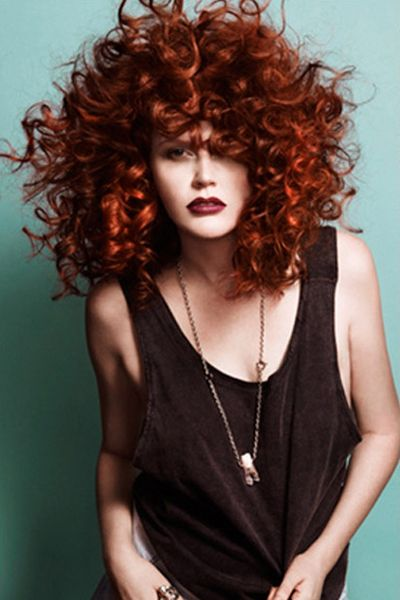 Beautiful big volumous Red curly afro, long hair.