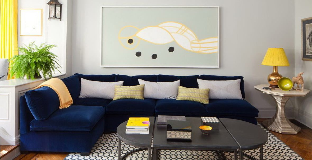 Minimalist Living Room Design With Dark Blue Sofa Jpg 1180 608 Blue Sofas Living Room Blue Couch Living Blue Sofa Living