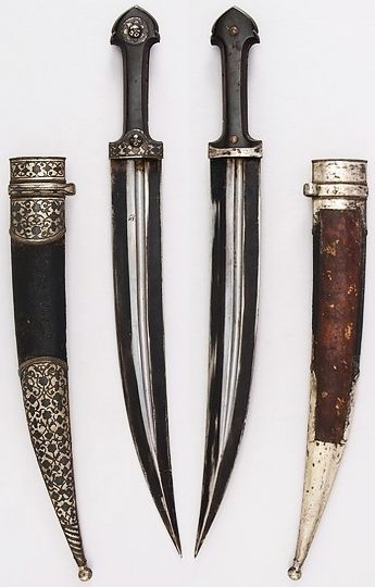 Caucasian (Cossack) qama / kindjal, 19th century, steel, leather, wood, silver, H. with sheath 17 13/16 in. (45.2 cm); H. without sheath 17 1/4 in. (43.8 cm); H. of blade 12 1/2 in. (31.8 cm); W. 1 11/16 in. (4.3 cm); Wt. 9.9 oz. (280.7 g); Wt. of sheath 2.8 oz. (79.4 g), Met Museum, Bequest of George C. Stone, 1935. [ Swordnarmory.com ] #Medieval #knights #swords