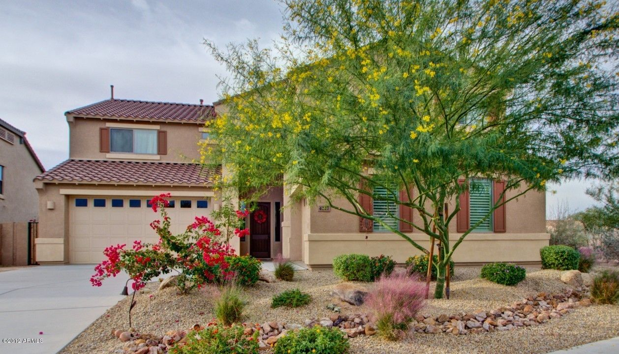 southwest yard replicating a colorful desert scene with a fake dry river bed front yard. Black Bedroom Furniture Sets. Home Design Ideas
