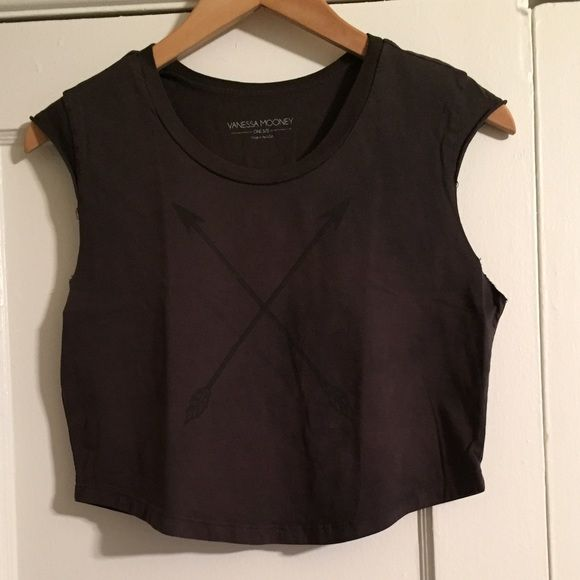 Vanessa Mooney Arrows Across My Heart Crop Tee NEW Vanessa Mooney Arrows Across My Heart Crop Tee. Vintage/weathered/faded dark gray with a faint graphic of black crossed arrows in x-design at chest. Small, cutoff cap sleeves, almost looks like a tank. Raw edges. Scoop, round neckline. Slightly oversized fit, cropped. Rounded hem. One size fits most. Please inquire for measurements if interested. 100% combed cotton. Made in the USA. So hip, trendy and stylish! Worn by Ashley Tisdale. Rare…