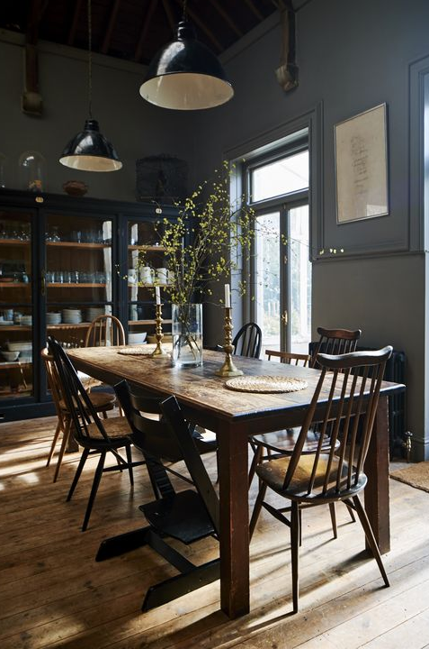 Dining Room With Dark Grey Walls And Industrial Lights