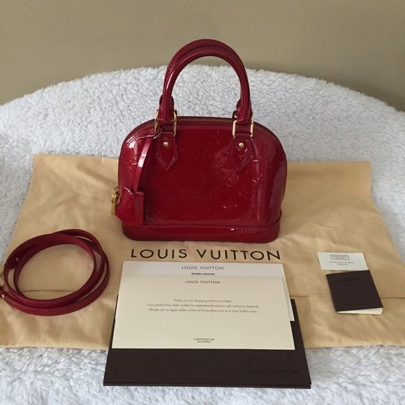 % authentic LV Alma BB Authentic Louis Vuitton Alma BB. Datecode SD0173 made in USA. Can wear with or without strap. Beautiful Red color in Vernis style and gold hardware. Come with crossbody strap, dust bag, lock and 2 keys no. 314, tag, booklet and some paperworks. No reciept, No box. Outside looks fantastic, a little dirty inside from normal wear as pictured but nothing major. Sold as is. Louis Vuitton Bags Crossbody Bags