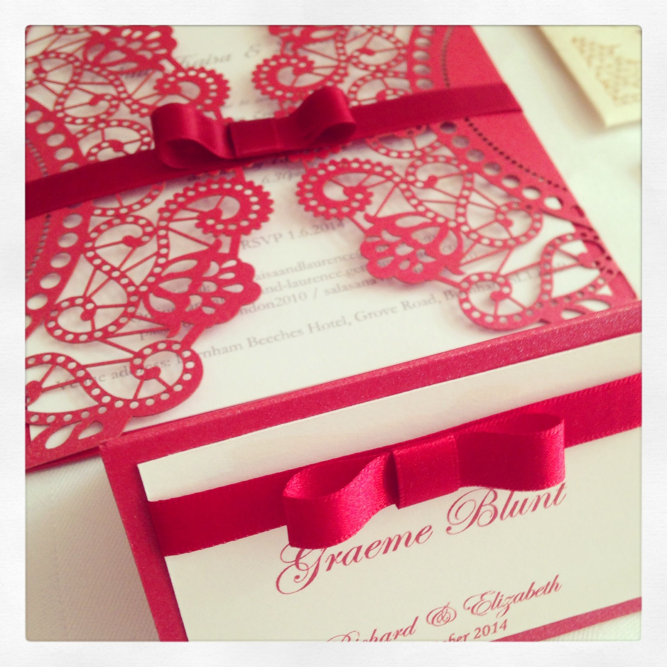 Scarlet red laser cut doily wedding invitation with co-ordinating ...