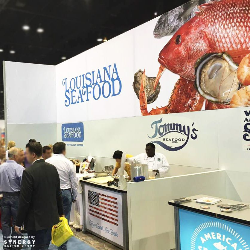 Guests sample client Louisiana Seafood Board's offerings