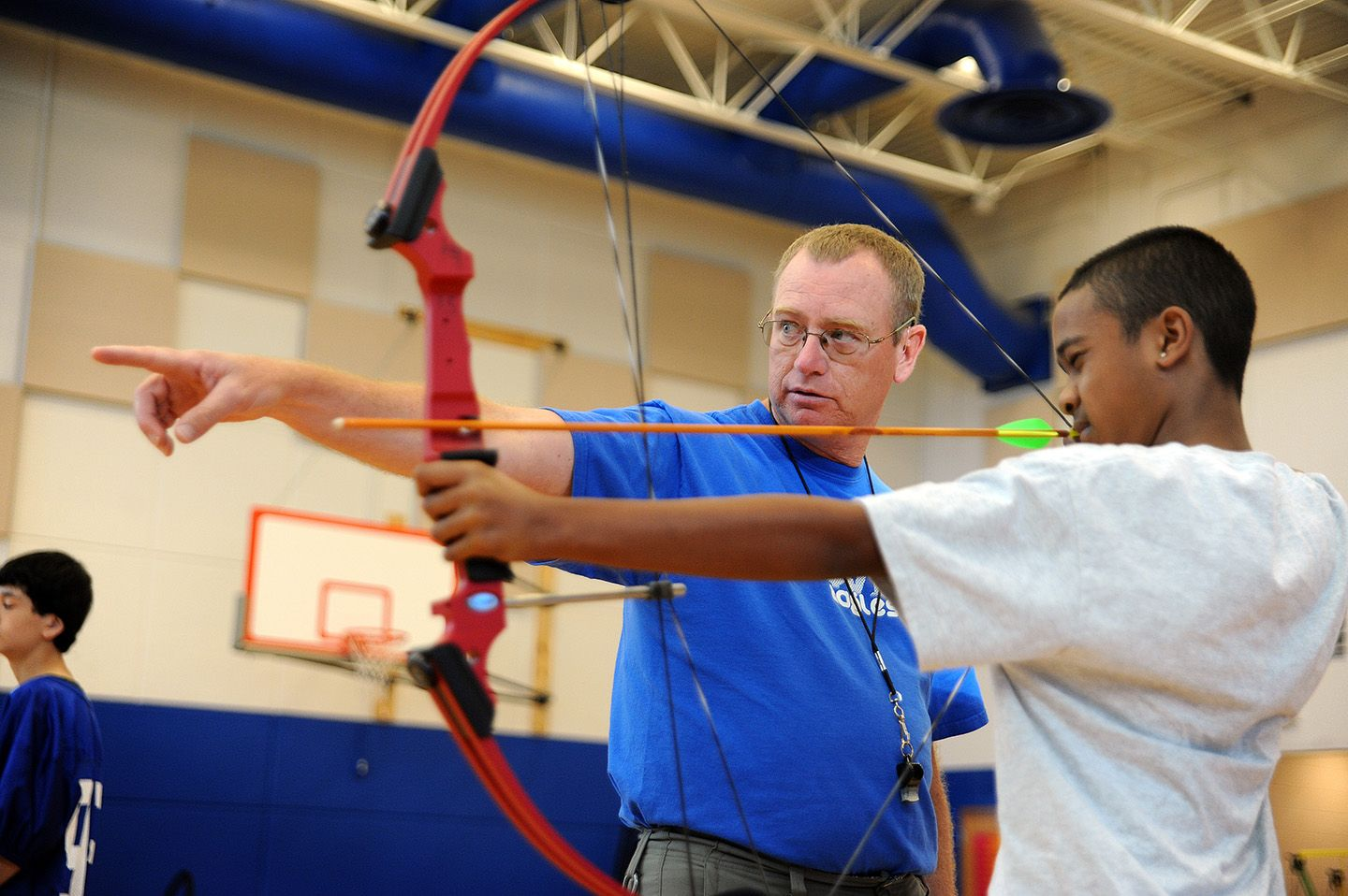 Physical Education Teacher Don Moore Helps Student