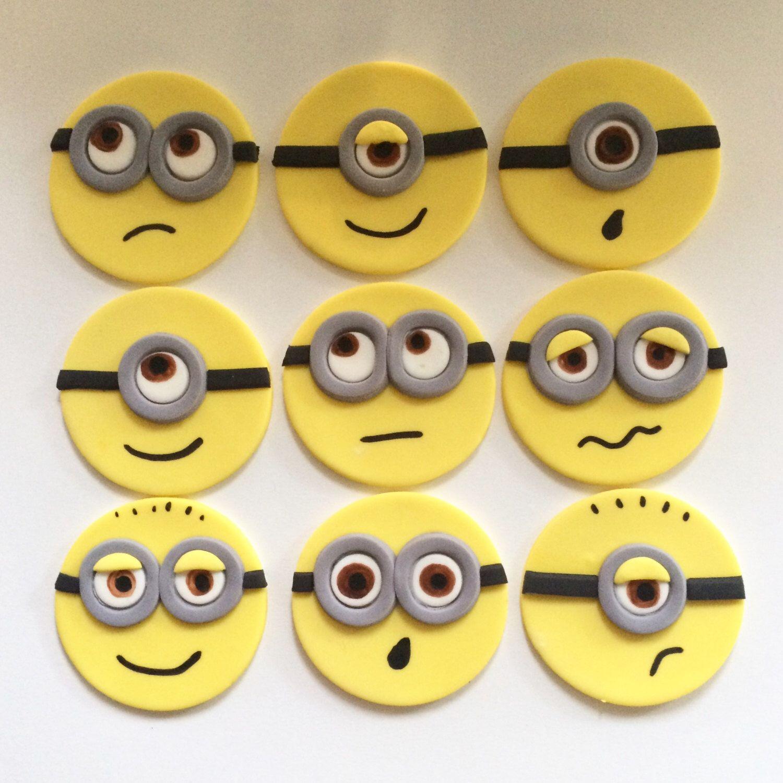Minion Cupcake Toppers | Fondant by MilkandHoneyCakery on Etsy https://www.etsy.com/listing/249767383/minion-cupcake-toppers-fondant