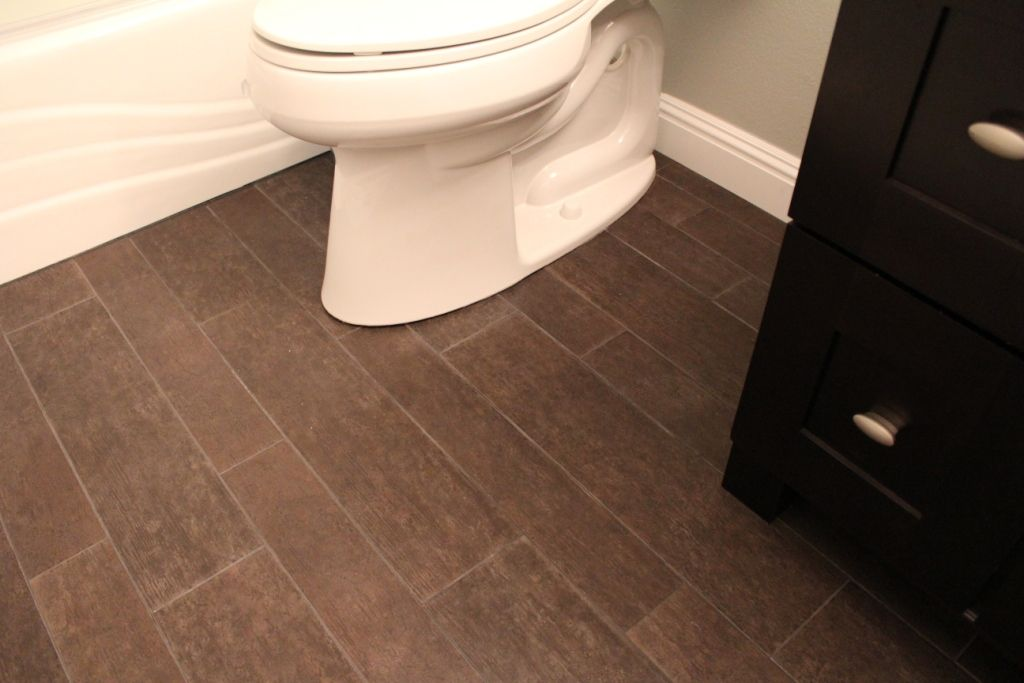 Tile that looks like hardwood in love with this maybe for Fake hardwood tile