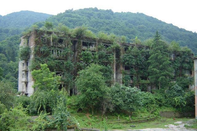 soviet housing block decay  The earth takes back....