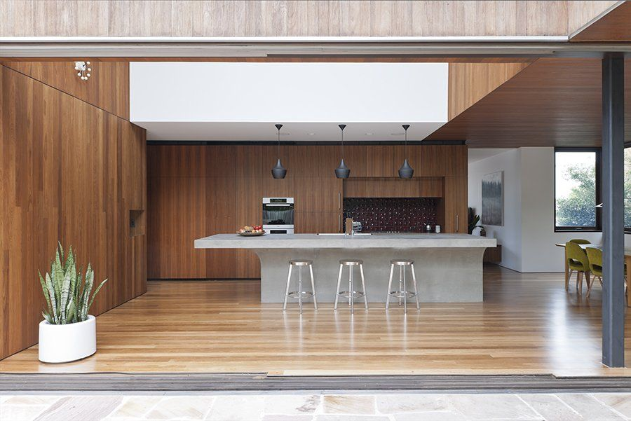 Concrete Island Bench Floating As An Island Surrounded By Timber Feature Modern House Design Concrete Countertops Kitchen Modern Kitchen
