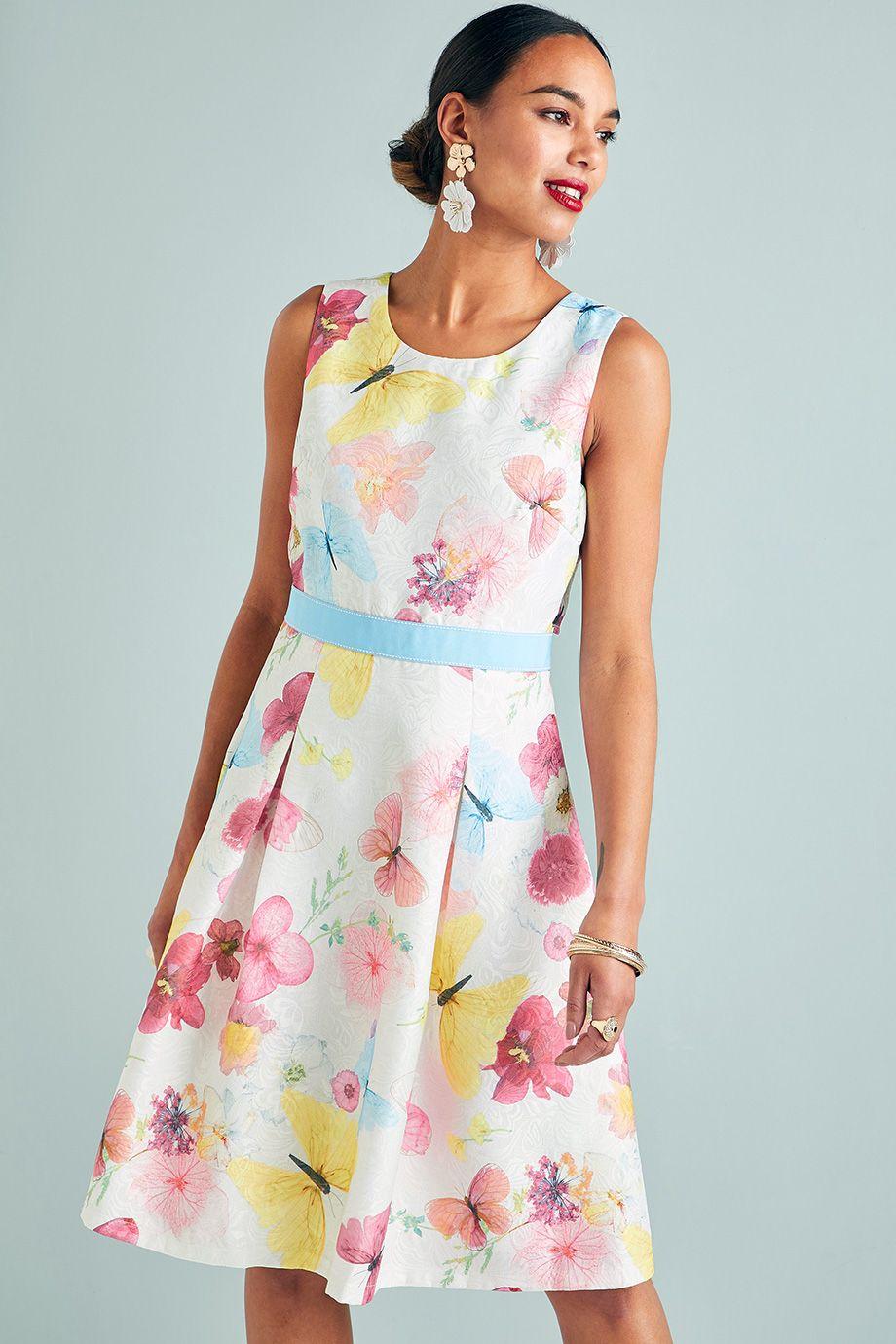 a8149ff3b5e Λευκο φορεμα απο μπροκαρ υφασμα με πεταλουδες, σιελ κορδελα στη μεση ...