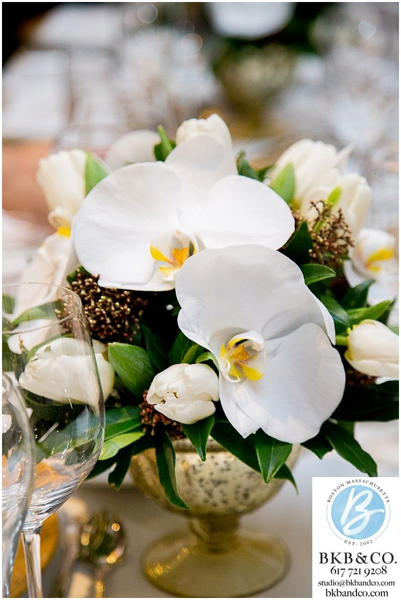 White orchid centerpieces in a gold vase for a beautiful summer ...