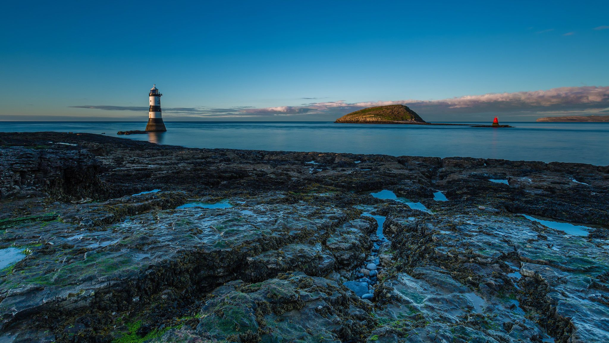 https://flic.kr/p/mLHKhi | 'Clear Blue Skies' - Trwyn Du, Anglesey | I'd kinda forgotten what a clear blue sky looked like.   Tonight I went chasing some tasty looking clouds, but as I got closer, they went further away. Still, I managed to catch this image which presented the last rays of the day as the sun went down behind me.  However, I then jumped back in my car and went Warp 9 (where Warp 9 = the safe and legal speed limit!) to the other side of the island to see if there were any…